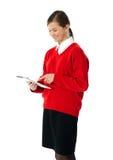 Adolescente hermoso usando la tableta electrónica Fotografía de archivo