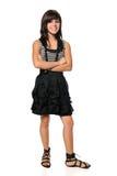 Adolescente hispánico con los brazos cruzados Imagenes de archivo