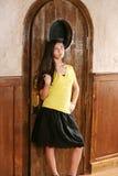 Adolescente hispánico en falda Foto de archivo libre de regalías