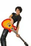 Adolescente hispánico feliz con la guitarra eléctrica Foto de archivo libre de regalías