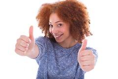 Adolescente hispánico joven que hace los pulgares encima del gesto aislados encendido Imagen de archivo libre de regalías
