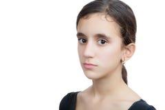 Adolescente hispánico serio aislado en blanco Fotos de archivo