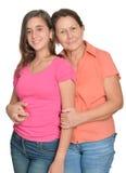 Adolescente hispánico y su abuela aislados en blanco Fotos de archivo libres de regalías