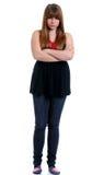 Adolescente infeliz con sus brazos cruzados Imagen de archivo libre de regalías
