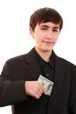 Adolescente ingenioso con una denominación 100 $ Imagen de archivo