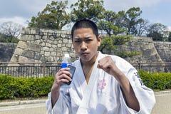 Adolescente japonés en la posición del karate Imagenes de archivo