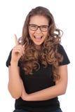 Adolescente joven atractivo que tiene una buena idea - aislada sobre un w Foto de archivo