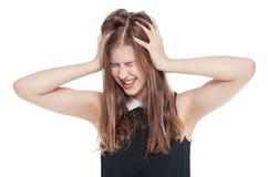 Adolescente joven con dolor de cabeza aislado Imagen de archivo