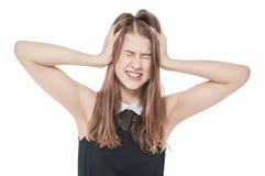 Adolescente joven con dolor de cabeza aislado Imagen de archivo libre de regalías