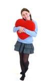 Adolescente joven con el corazón rojo Imagenes de archivo
