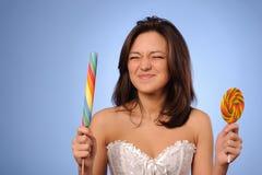 Adolescente joven con el lollipop Imagen de archivo libre de regalías