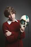 Adolescente joven con la máscara veneciana Foto de archivo