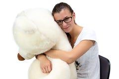 Adolescente joven con los vidrios weared del oso de peluche Imagenes de archivo