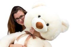 Adolescente joven feliz con el oso de peluche Foto de archivo libre de regalías