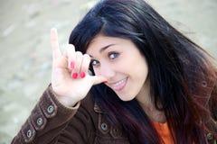 Adolescente joven feliz que hace la cara divertida Imágenes de archivo libres de regalías