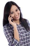 Adolescente joven que habla en el teléfono Imagen de archivo libre de regalías
