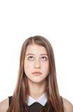 Adolescente joven que mira para arriba en algo aislado Imagen de archivo