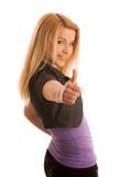 Adolescente joven que muestra el pulgar para arriba como muestra del éxito y del hap Fotos de archivo libres de regalías