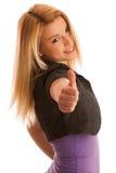 Adolescente joven que muestra el pulgar para arriba como muestra del éxito y del hap Fotografía de archivo