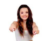 Adolescente joven que señala en la cámara con su dedo índice Imágenes de archivo libres de regalías