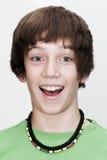 Adolescente joven sorprendente con la boca ampliable Foto de archivo