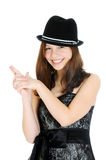 Adolescente joven trigueno atractivo con la mano en dimensión de una variable de un arma Fotografía de archivo libre de regalías