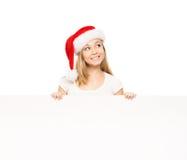 Adolescente joven y feliz en un sombrero de la Navidad que sostiene una bandera Imagen de archivo