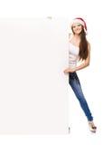Adolescente joven y feliz en un sombrero de la Navidad que sostiene una bandera Fotografía de archivo
