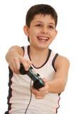 Adolescente jugando un juego de ordenador con la palanca de mando Fotos de archivo