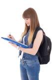 Adolescente lindo con el cuaderno y la mochila aislados en blanco Fotografía de archivo libre de regalías
