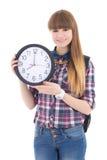 Adolescente lindo con el reloj aislado en blanco Foto de archivo