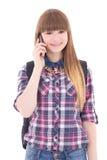 Adolescente lindo con el teléfono móvil aislado en blanco Fotos de archivo libres de regalías