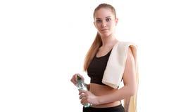 Adolescente lindo con la botella de agua en manos Imagen de archivo libre de regalías