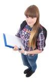 Adolescente lindo con la mochila aislada en blanco Fotos de archivo libres de regalías