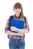 Adolescente lindo con la mochila y carpeta aislada en blanco Foto de archivo libre de regalías