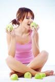 Adolescente lindo con las manzanas Imagen de archivo
