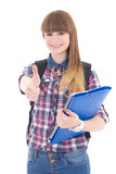 Adolescente lindo con los pulgares de la mochila y de la carpeta para arriba aislados encendido Fotografía de archivo libre de regalías
