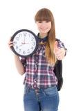 Adolescente lindo con los pulgares del reloj para arriba aislados en blanco Fotos de archivo