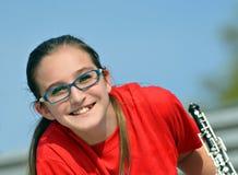 Adolescente lindo con un oboe Fotografía de archivo libre de regalías