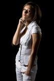 Adolescente lindo contra fondo negro Imagenes de archivo