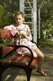 Adolescente lindo en el vestido de flores Fotos de archivo