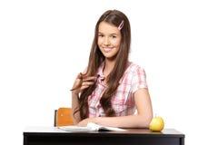 Adolescente lindo que juega con su pelo en escuela Imágenes de archivo libres de regalías