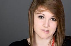 Adolescente lindo que muerde su labio Fotografía de archivo