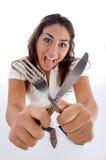Adolescente lindo que muestra la cuchillería Imágenes de archivo libres de regalías