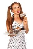 Adolescente lindo que sostiene manzanas de caramelo Fotografía de archivo libre de regalías