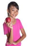 Adolescente malayo asiático joven con Apple rojo VIII Fotografía de archivo libre de regalías