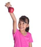 Adolescente malayo asiático joven con Apple rojo XI Fotos de archivo