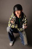 Adolescente masculino en casco Imagen de archivo