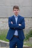 Adolescente masculino joven del negocio en traje azul Imágenes de archivo libres de regalías