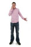 Adolescente masculino pecoso lindo en el teléfono Foto de archivo libre de regalías